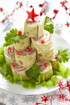 Roll up tortilla, ham and cheese for Christmas Stock Photo