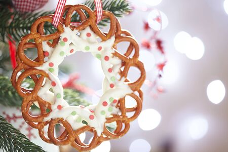 Christmas Decoration with chocolate covered pretzels wreath photo