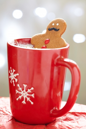 Gingerbread cookie men in a hot cup of cappuccino Stock Photo - 23482027