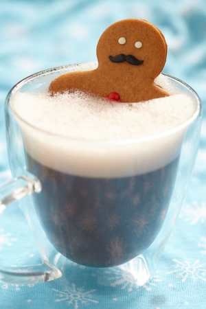 Gingerbread cookie men in a hot cup of cappuccino photo