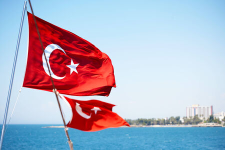 Turkish flag on the ship in sea photo