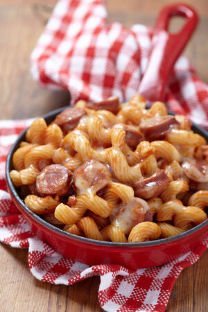 cooked sausage: pasta with smoked sausage and cheesy tomato sauce