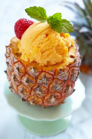 Small pineapple stuffed fruit sorbet ice cream