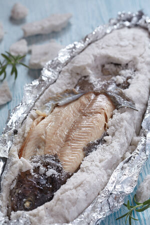 Rainbow trout fish baked in  sea salt photo