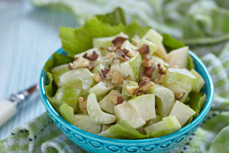 Waldorf salad with green apples, celery and walnuts photo