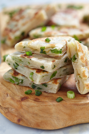 Chinese green onion pancakes on wooden board