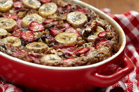 Strawberry Banana Oatmeal with chocolate and pecan nuts photo