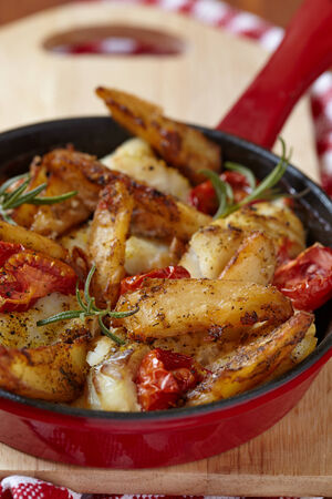 baked fish with vegetables patatoes and tomatoes photo