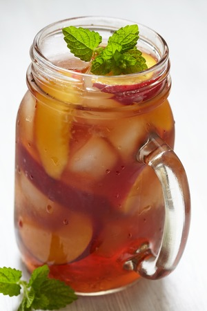 Fresh peach ice tea in a mason jar Stock Photo