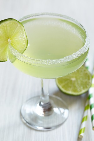 margarita cocktail with lime on white table photo