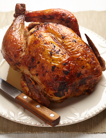 Whole Roasted Chicken on plate for holidays Stock Photo