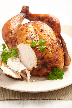 roast chicken: Whole Roasted Chicken on plate for holidays Stock Photo