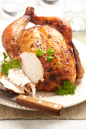whole chicken: Whole Roasted Chicken on plate for holidays Stock Photo