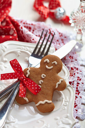 Table setting with gingerbread man for Christmas photo