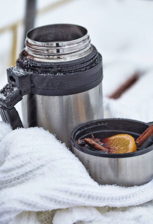 thermos: Mulled wine on a bench in winter park