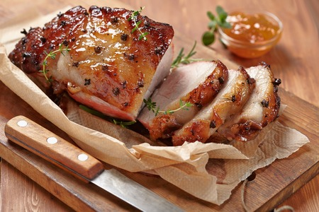 baked: Baked meat with orange fruit jam and allspice Stock Photo