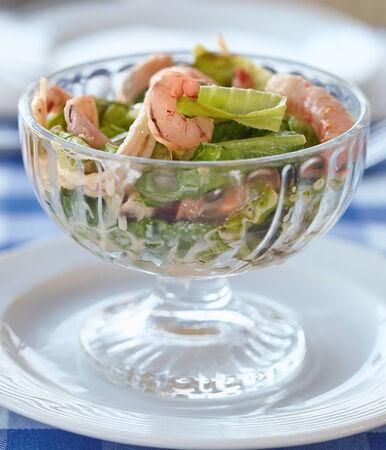 Fresh green salad with shrimp and avocado photo