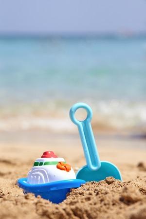 beach toys: Childrens toys on a sand beach