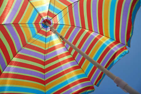Beach umbrella with a blue sky in sunny day photo