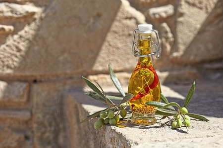 olive oil bottle: Aromatic olive oil in a bottle with herb, pepper and mustard seeds