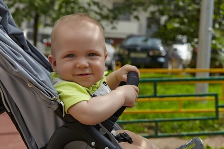 Little adorable baby boy in a stoller