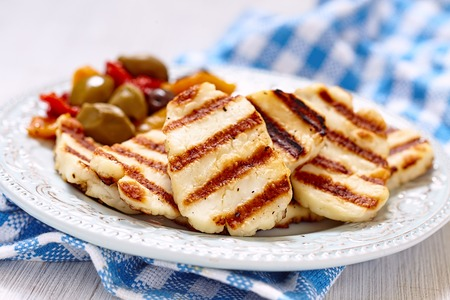 Grilled halloumi cheese with olives and pepers