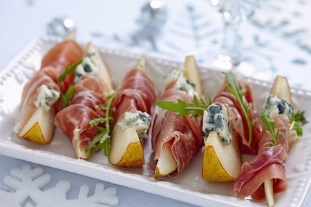 Appetizer with pear, prosciutto and blue cheese for holidays