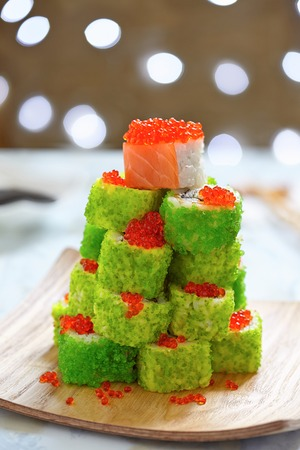 Maki Sushi Roll Christmas Tree on a table Stock Photo
