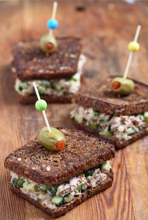 pumpernickel: Tuna salad sandwich with pumpernickel bread and cucumber Stock Photo