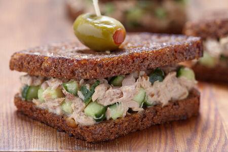 wholegrain mustard: Tuna salad sandwich with pumpernickel bread and cucumber Stock Photo