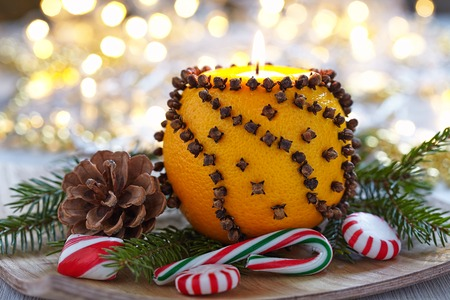 Aromatic Christmas orange with cloves and candle photo