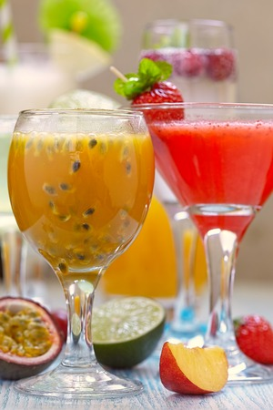 passion fruit: Fresh tropical cocktail with orange, peach and passion fruit Stock Photo