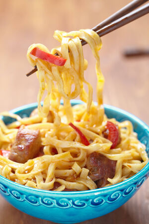 Asian noodles with pork meat and pepper photo