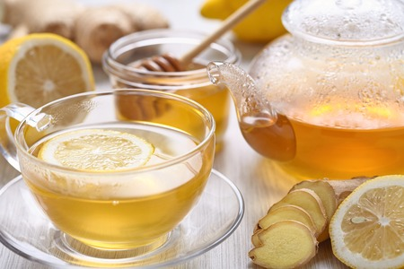 herb tea: Cup of ginger tea with honey and lemon on wooden table Stock Photo