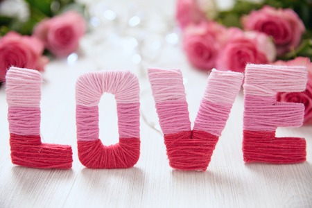 Valentines day concept with letters love and flowers photo