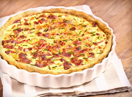 Savory pie with chicken, bacon, onion and pepper Stock Photo