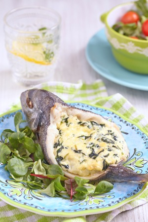 Roasted Sea Bream fish stuffed with spinach photo