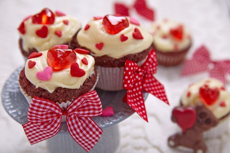 Red velvet cupcakes decorated with hearts for Valentines day Stock Photo