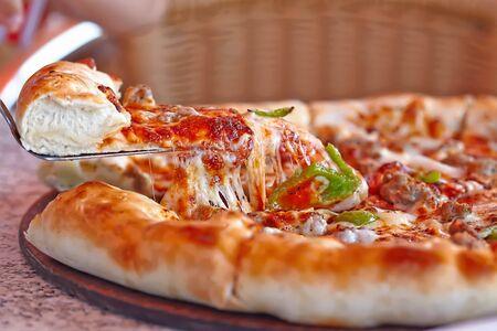 Fresh italian pizza with cheesy board