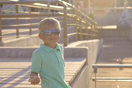 Portrait of adorable baby boy with sunglasses photo
