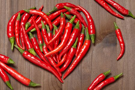 thai pepper: Chili pepper heart on a wooden background