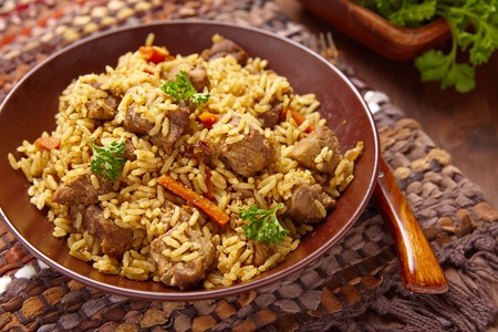 are fried: Rice pilaf with lamb meat and vegetables