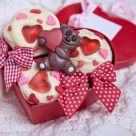 red velvet cupcake: Red velvet cupcakes decorated with hearts for Valentines day Stock Photo