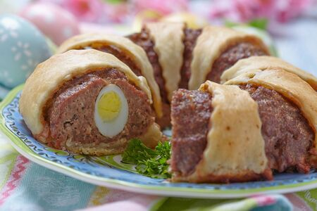 MEAT LOAF: Meatloaf ring stuffed eggs for a Easter Stock Photo