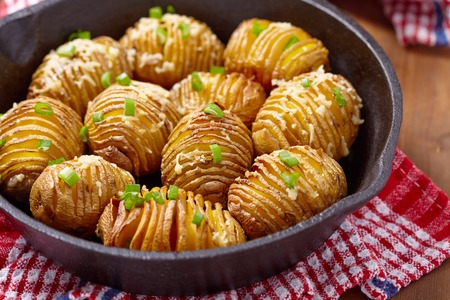 recipe background: Baked hasselback potatoes with cheese and green onion