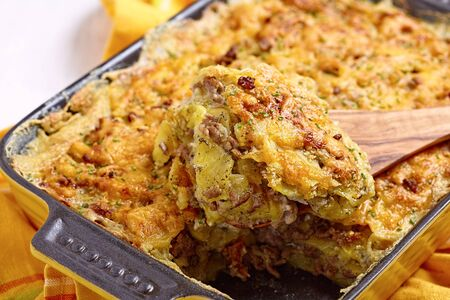 ground beef: Baked Potato Gratin with Beef Ground Meat Stock Photo