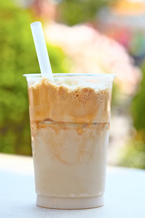 to go cup: Iced coffee in plastic cup with straw
