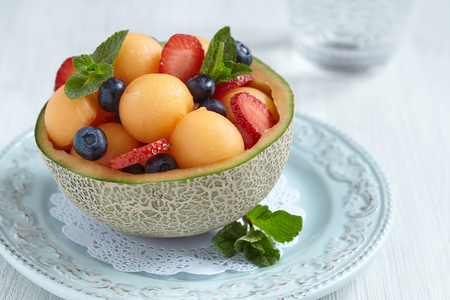 Fruit salad with melon, strawberry and blueberry Imagens