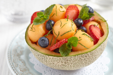 water melon: Fruit salad with melon, strawberry and blueberry Stock Photo