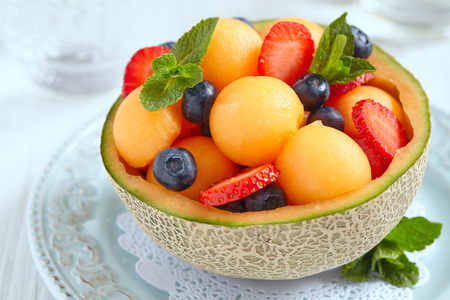 Fruit salad with melon, strawberry and blueberry Foto de archivo